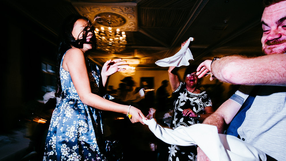 Guests throwing napkins at each other. Manchester wedding