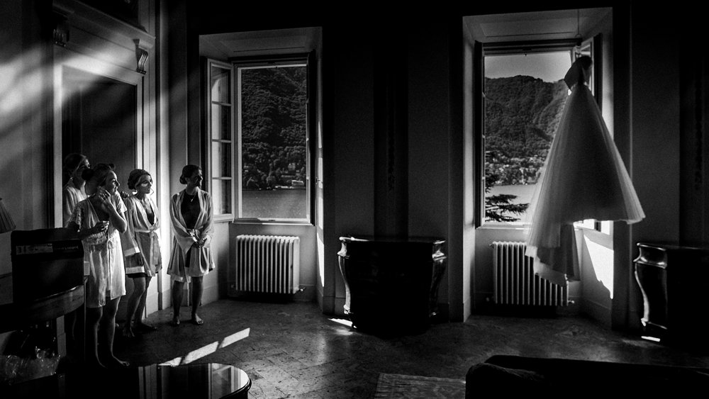 admiring the wedding dress at luxury wedding venue on lake como
