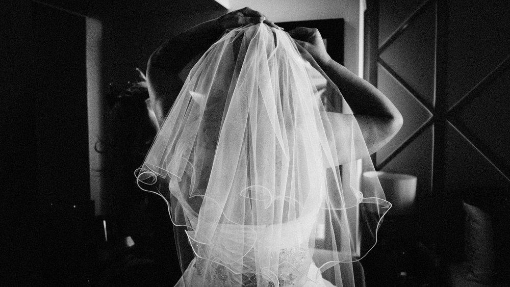 bride putting on veil in essex