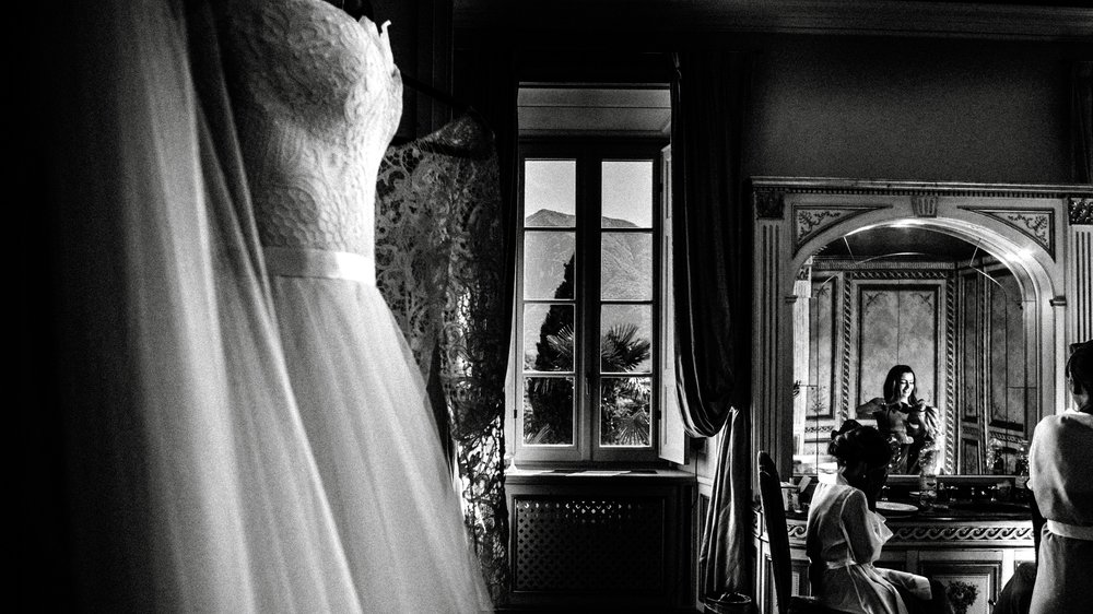 a stunning wedding dress hanging up ready for wedding in lake como italy