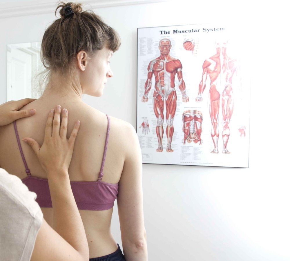 Colette the osteopath performing a standing examination
