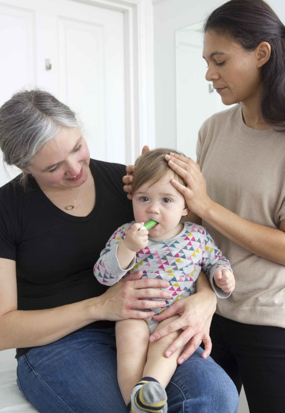 Colette osteopath treating baby with cranial osteopathy
