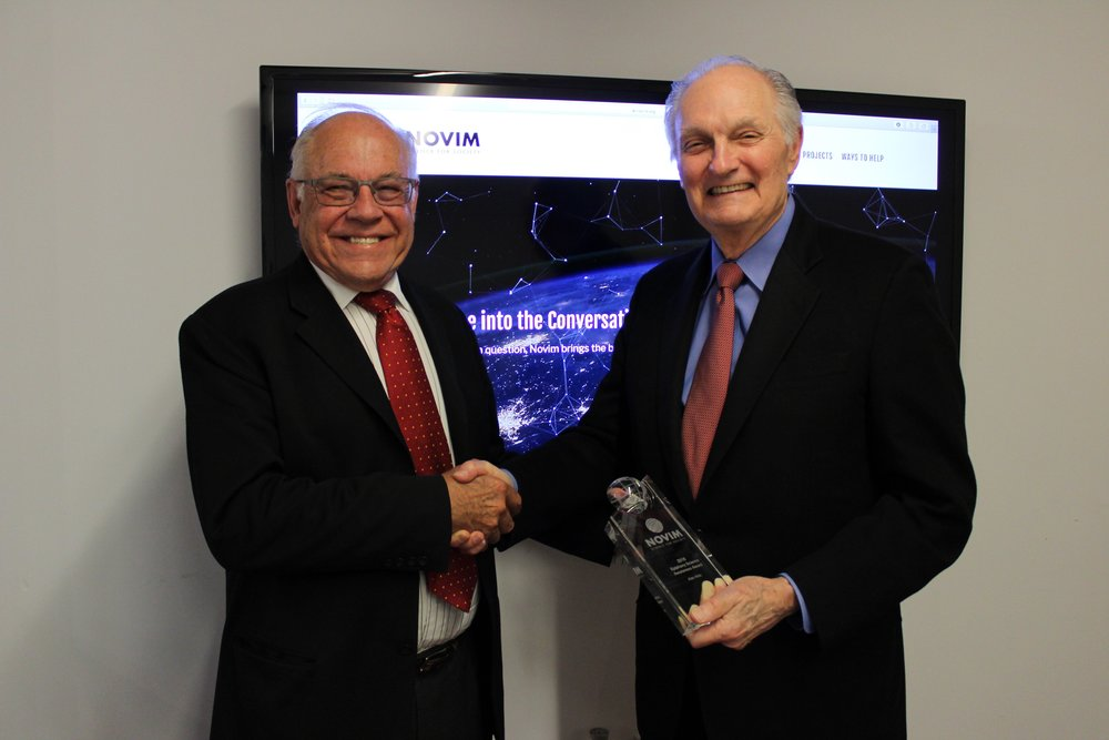 Chuck House congratulates Alan Alda on his AJN Science Awareness Award