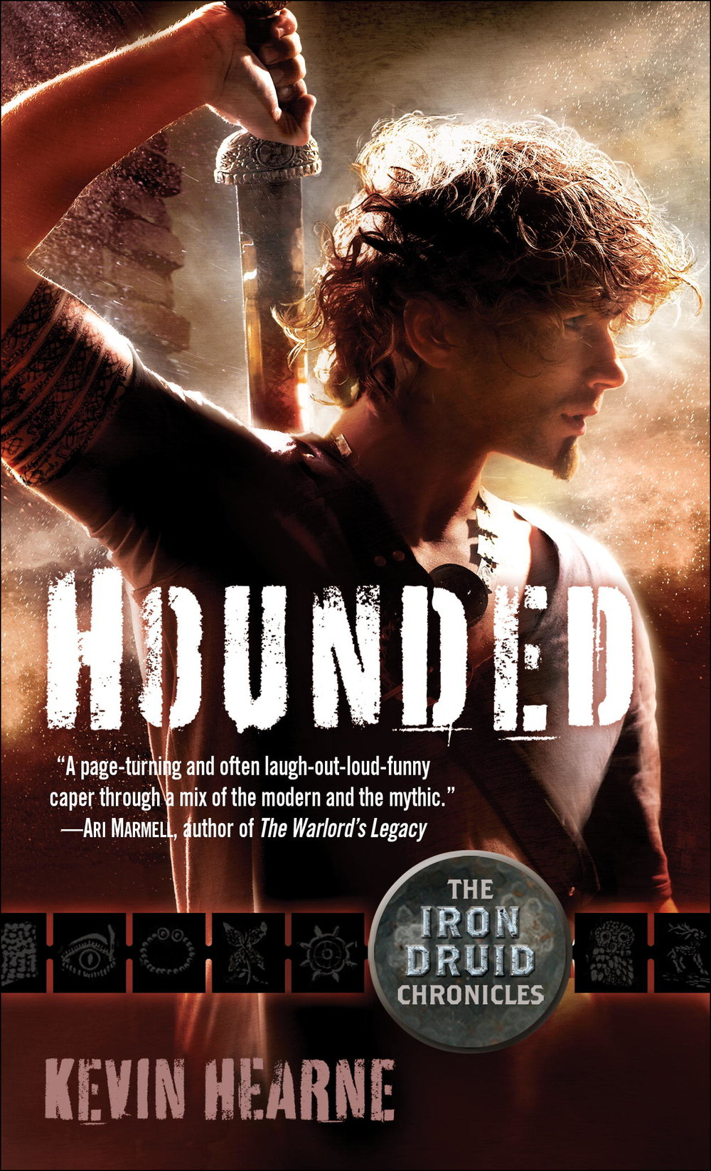 Hounded by Kevin Hearne with a young, fit, red-haired man reaching behind his back to draw his sword