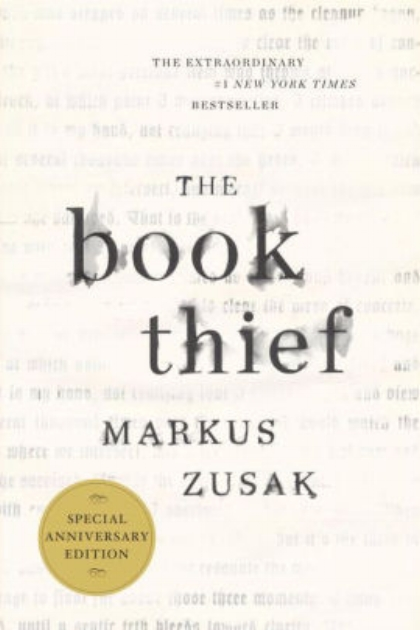 The Book Theif by Markus Zusak white cover with faded words in the background