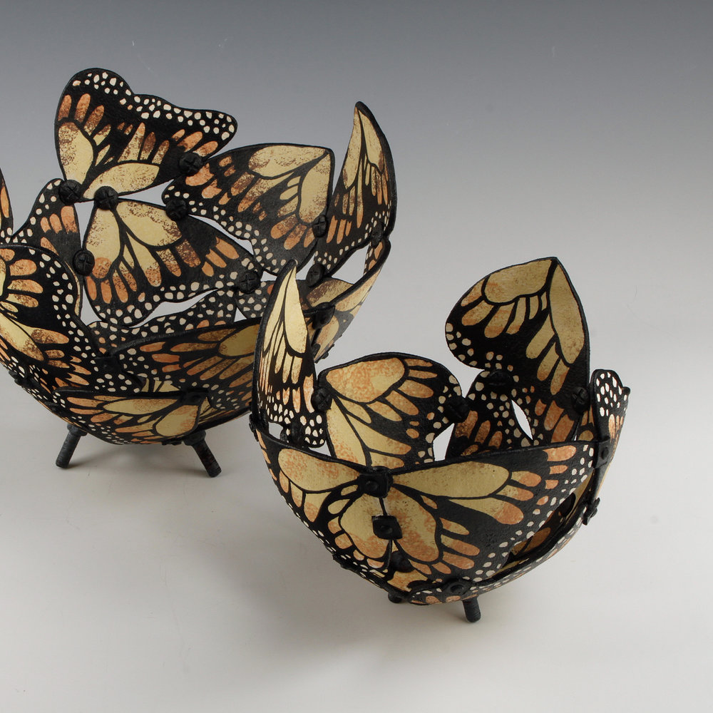 Fiona Mazza   Fiona is a Yorkshire based ceramic artist who uses nature to form the basis of her work. With a particular interest in butterflies, Fiona uses various techniques to capture the beauty of this insect, with Raku being the main technical process to create subtle effects to enhance the delicate forms.