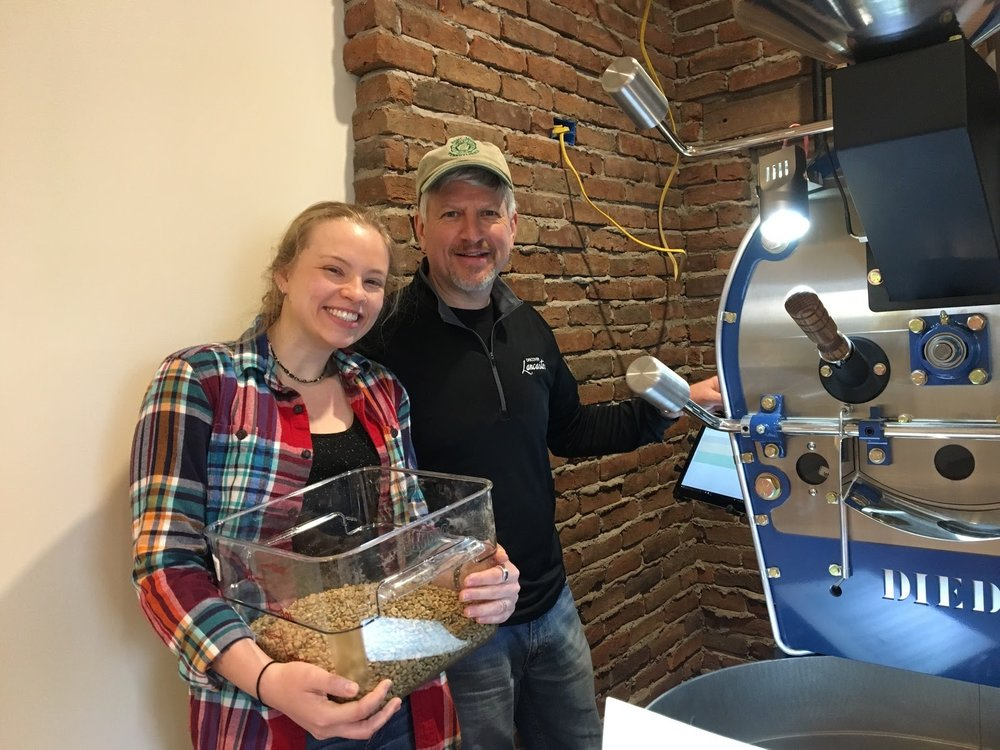"Our Story… - This is my Dad and me. This picture was taken our first day roasting on our very own coffee roaster back in March of 2017. People always ask me how I got started coffee roasting. And I tell them that it all began with an air popcorn popper on our deck, as it always does. Well we soon (accidentally) destroyed the popcorn popper with overuse- roasting coffee, in any form, is a lot of fun. After that we decided to move to the big leagues, and bought a little 1lb Fresh Roast air roaster. We learned a lot from using the Fresh Roast because we could track temperatures on the computer. You can't do THAT with a popcorn popper! After that it all spiraled very quickly out of control. I told my Dad, ""I want to do this for real. We need to get a roaster- a big one"". It didn't take long to convince him- corporate life is irritating and stressful. Coffee roasting is certainly not.A few months later we were flying to Ponderay, Idaho for our first roasting class at the Diedrich manufacturing site, where we got to roast on an 10lb roaster. Now we were REALLY in the big leagues. We learned a ton and ordered our roaster (Big Blue as we would name him later) right then and there. Waiting was agony! But our roaster arrived in pristine condition (after having been built to order) in March of 2017. We quickly got to roasting and tasting in preparation for the opening of the General Store. I have never consumed so much coffee (with so much regret) as I did when we were working on the proportions for the house blend. Shaking slightly, and very dehydrated, we triumphantly declared that we had found the perfect blend!We have been growing ever since and are learning something new with every roast. Coffee roasting is quite an adventure. Each bean is different, and we enjoy finding the perfect roast, to give people the best tasting coffee possible. Come visit us at the Red Canoe General Store to see Big Blue and try the coffee that all started with a popcorn popper."