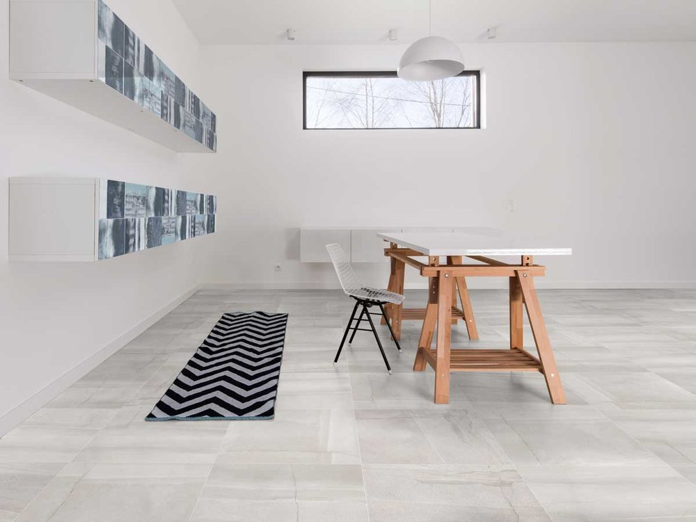 Stonetec Range - Simple and effective natural stone design available in 4 colourways: White, Light Grey, Taupe and Charcoal. Great affordable option for creating a natural stone look that blends with the environment. Available in a 600 x 600mm Matt finish.
