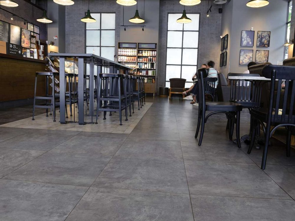 Manhatten Range - With the growing trend of urban, industrial inspired tiles the Manhattan range brings a subtle, almost polished look and feel. This range is a very cost effective way to achieve a concrete look surface that will stand the test of time.Available in 4 colours: White, Beige, Light Grey and Dark Grey. 3 finishes: Matt, Semi Polished and External.