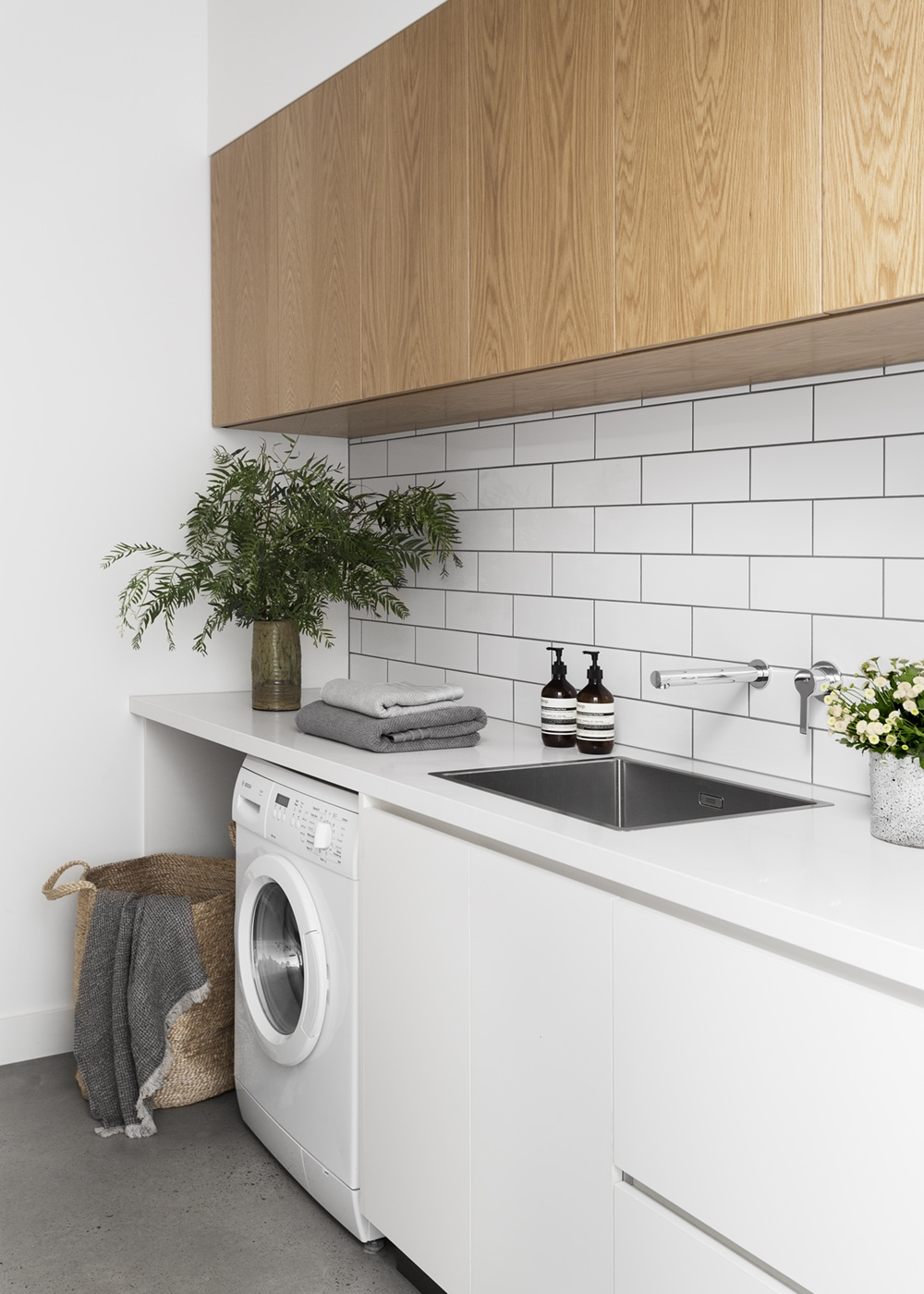 Design Tip:    Laundry habits and requirements vary from household to household. List core items and appliances that need to be allowed for in the design process to ensure everything has a place. For Bloomfield Road, an allowance was made for a dryer they felt their growing family didn't need just yet.