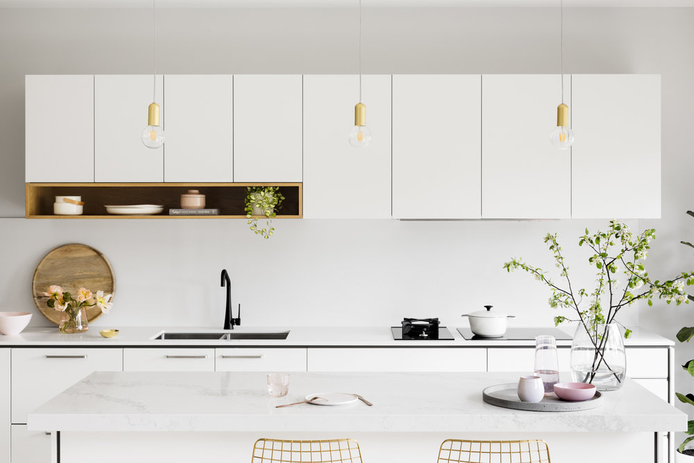 The palette for Were Street features two pack fronts in white and contrasting grey; oak veneer mitred boxes and open shelves; completed with crisp Caesarstone 'Snow' and marble-like 'Statuario Nuvo' with painterly grey veins.