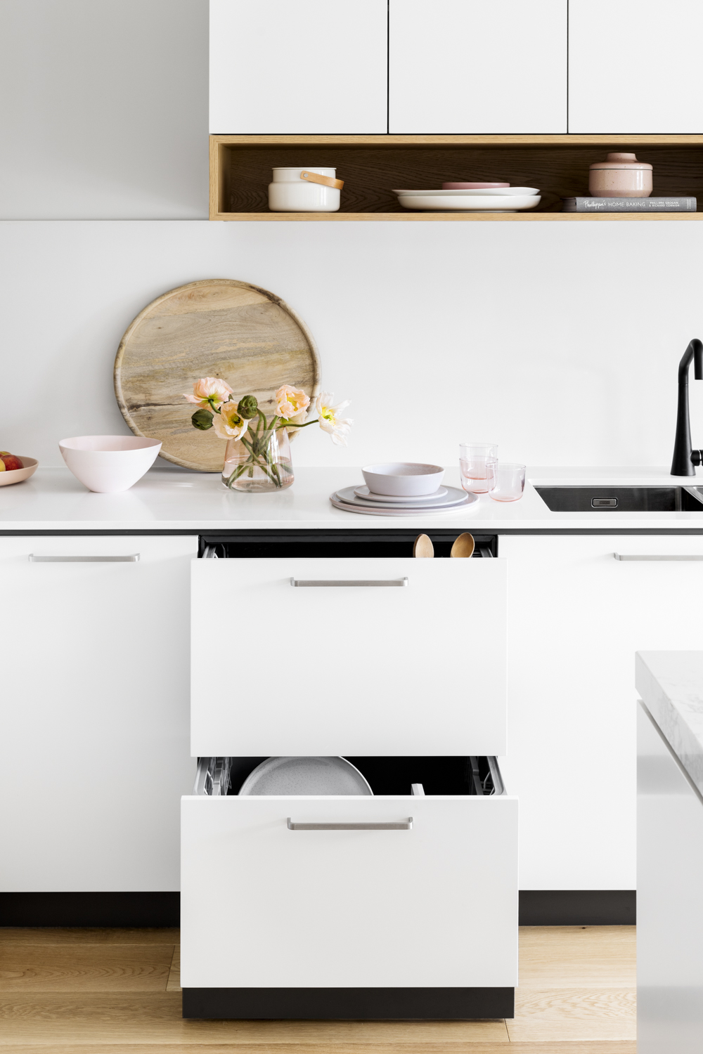 "Seamless integration continues with a Fisher Paykel dishdrawer which provides segmented washing for ""smaller loads during the week when it's just us and fast turn over when we're entertaining""."