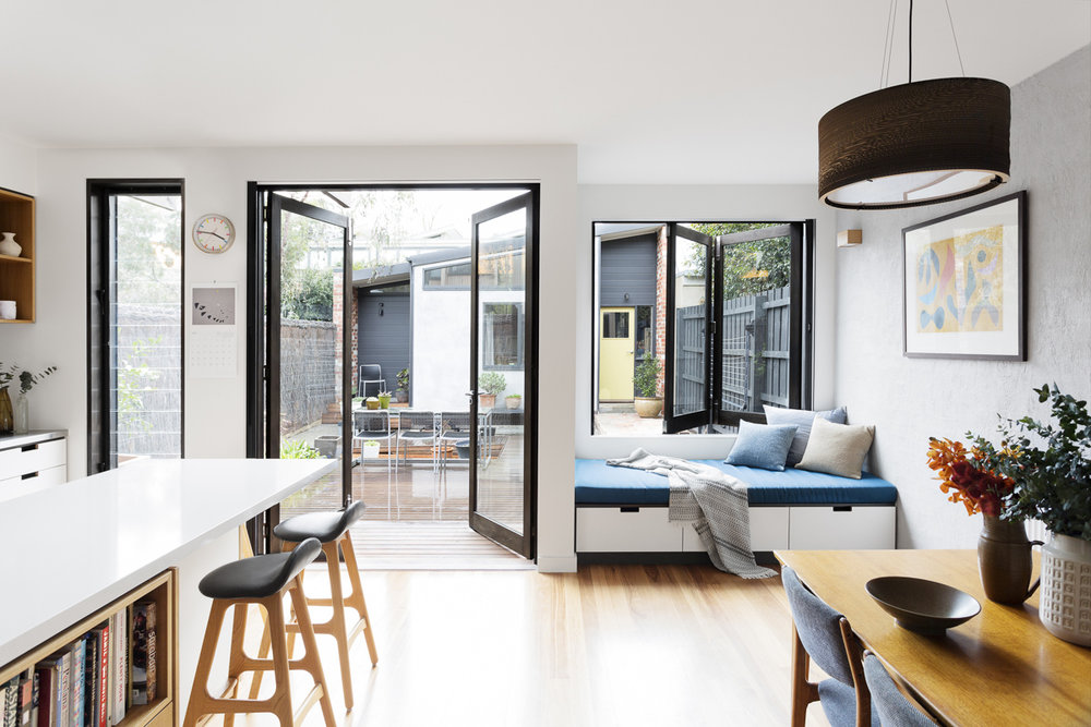 The kitchen-dining area opens out to a north facing courtyard. A separate studio is located at the rear of the block.