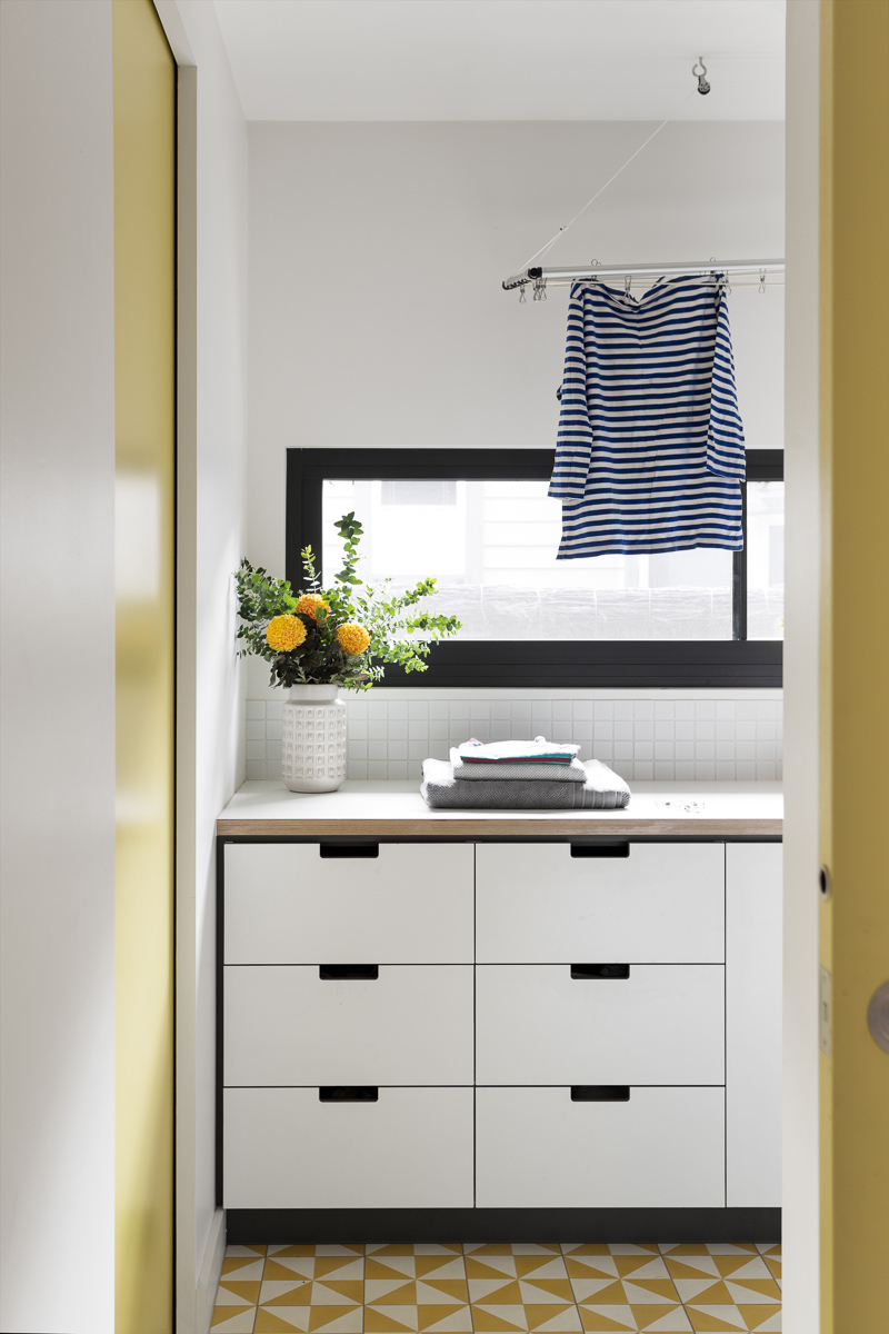 The laundry is fitted with Cantilever cupboards, providing a streamlined link between laundry, hallway cupboards and kitchen.