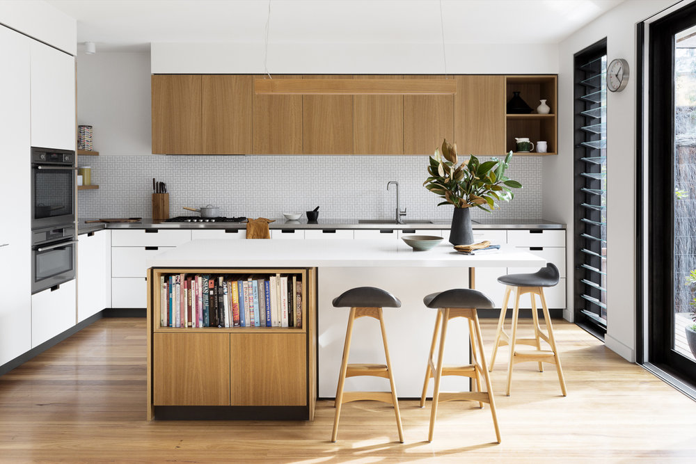 Cantilever K3 Kitchen System with Stainless Steel and Stone Benchtops with Blackbutt furniture elements at Creek House
