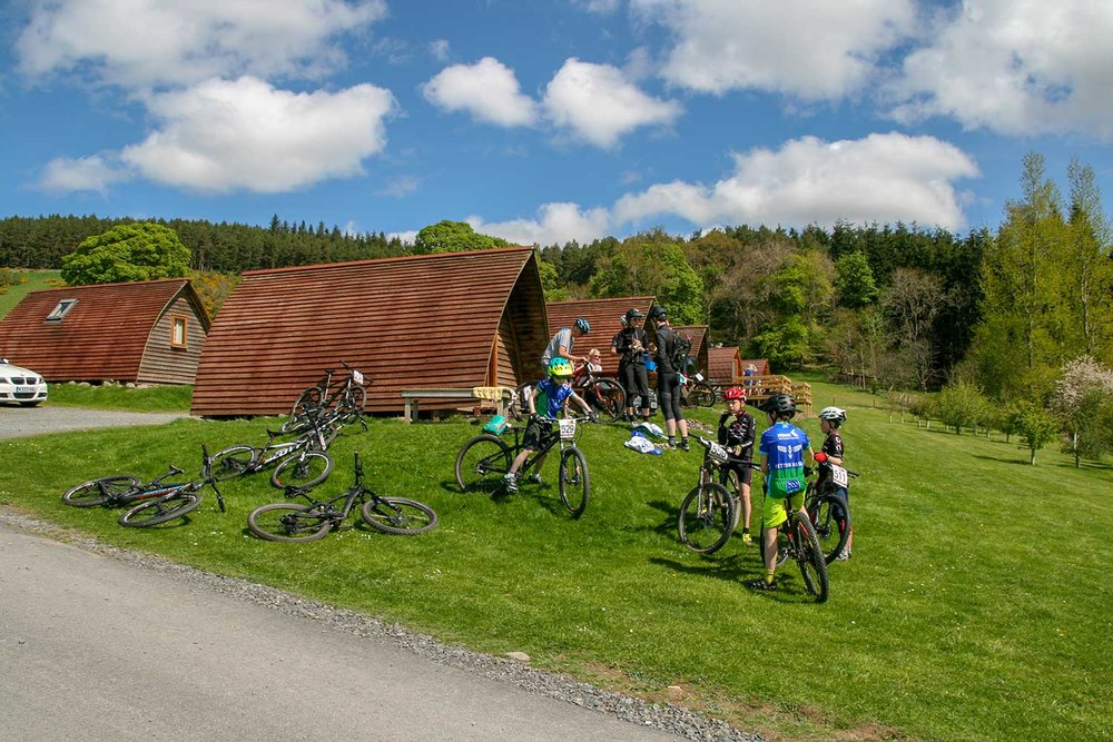 A family enjoying their stay at Glentress Forest Lodges