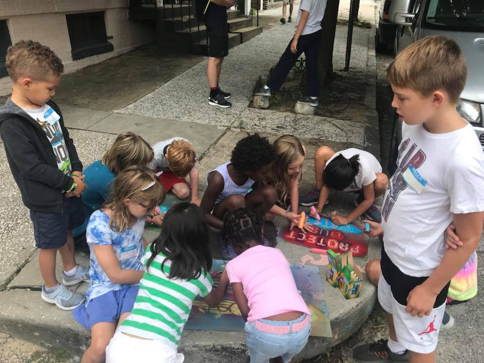 Campers stenciling stormwater drains.jpg