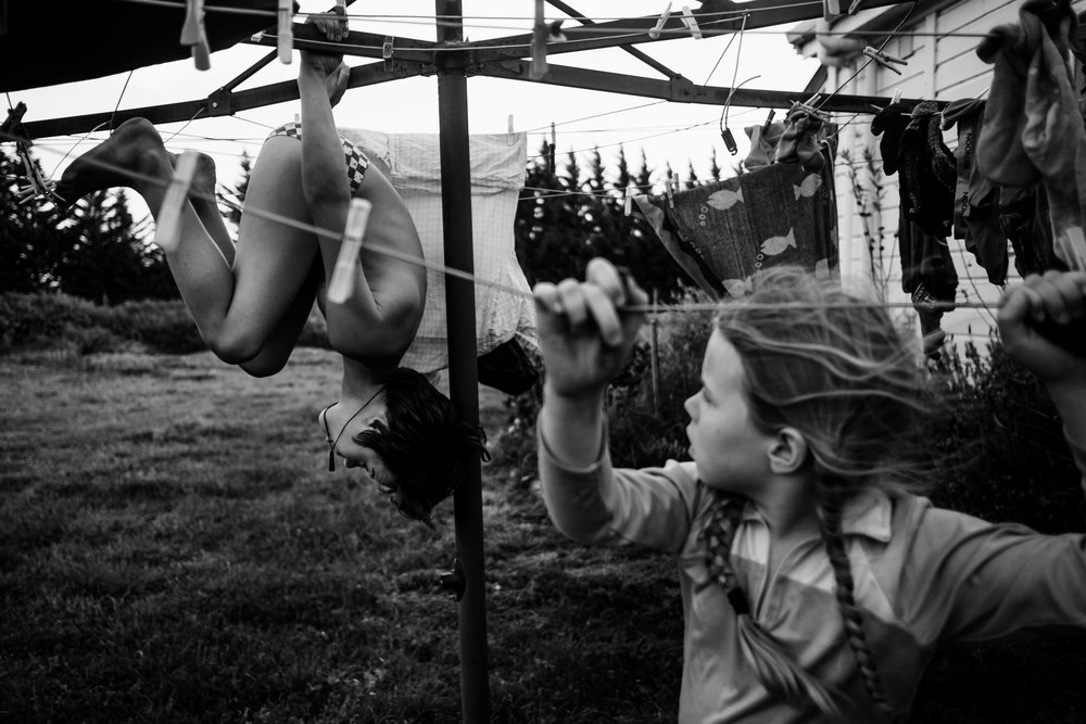 The Family Photographer Podcast Jenny Stein Interview with Niki Boon black and white photo of kids playing on clothesline