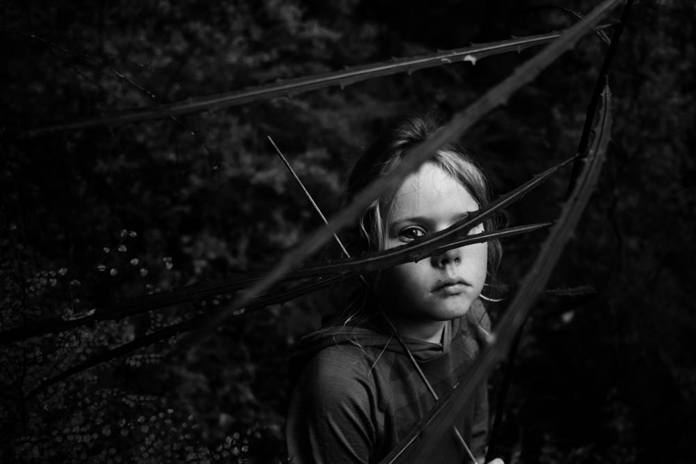 The Family Photographer Podcast Jenny Stein Interview with Niki Boon photo of child looking through vines