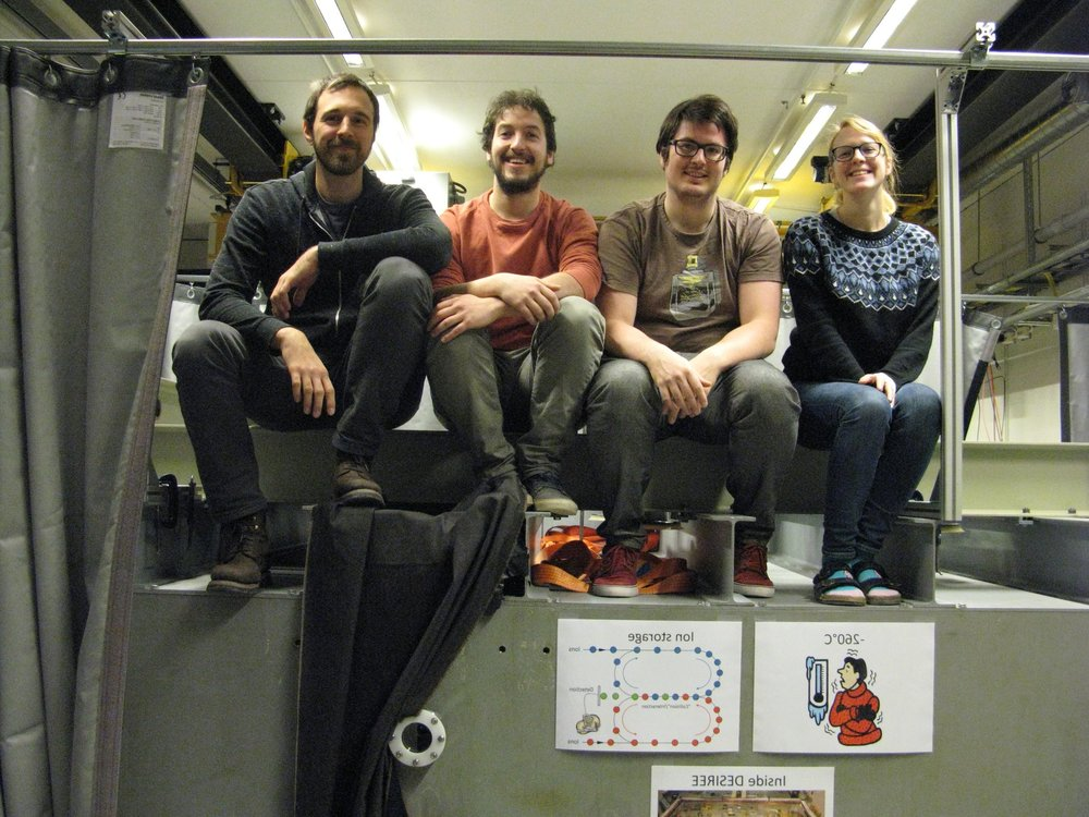 Users Paul Martini, Felix Laimer, Lorenz Kranabetter from the University of Innsbruck and Stockholm University PhD student Moa Kristansson atop the DESIREE main vessel.