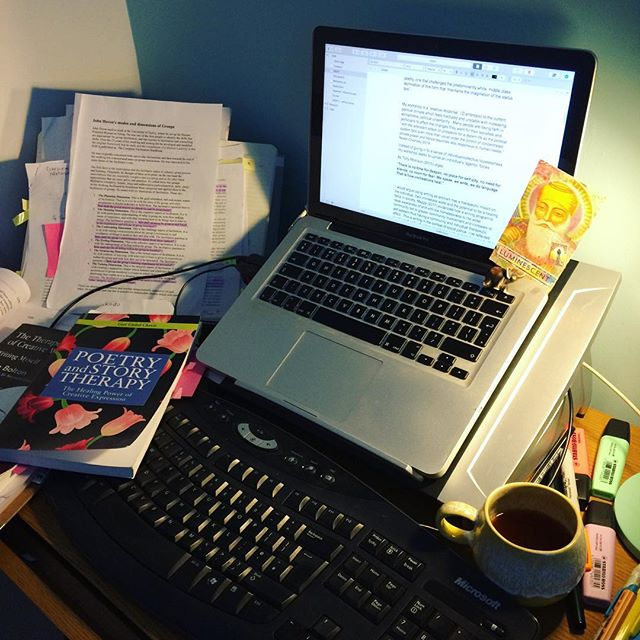 ESSAY CAVE 2. It's getting messy in here. Disparate ideas are coming together. Slowly. Writing a critique on my writing workshop 'Love will Conquer Hate', one of 6 from a series 'Writing as Activism'. Laptop is now Guru-powered 💕✊🏽🖌📖💻🙏🏽💕