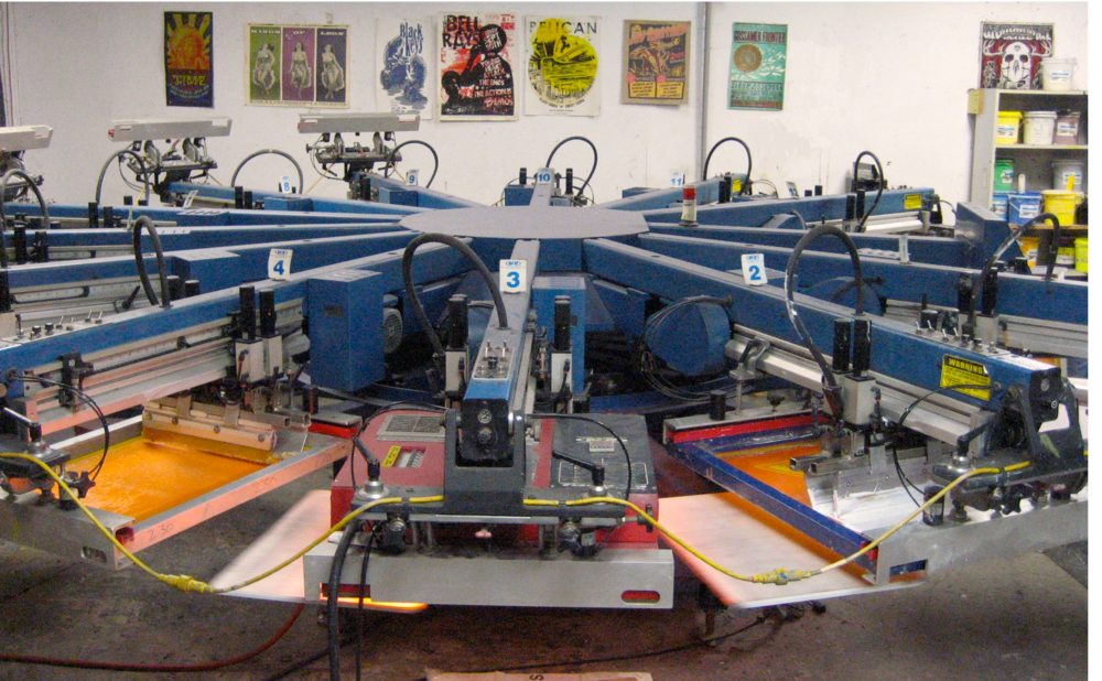 Automatic electric screen printing machine at Pork Chop Screen Printing in Austin, Texas.