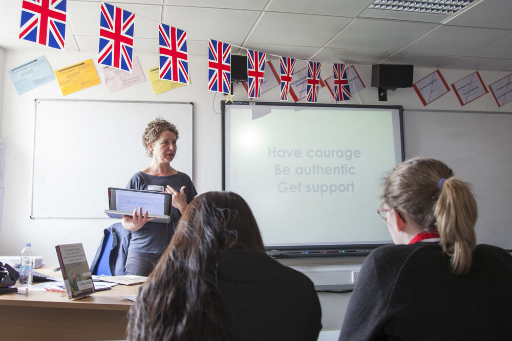 Photo of Ruth Davey giving a talk to room of delegates during a mindfulness photography presentation in Gloucestershire