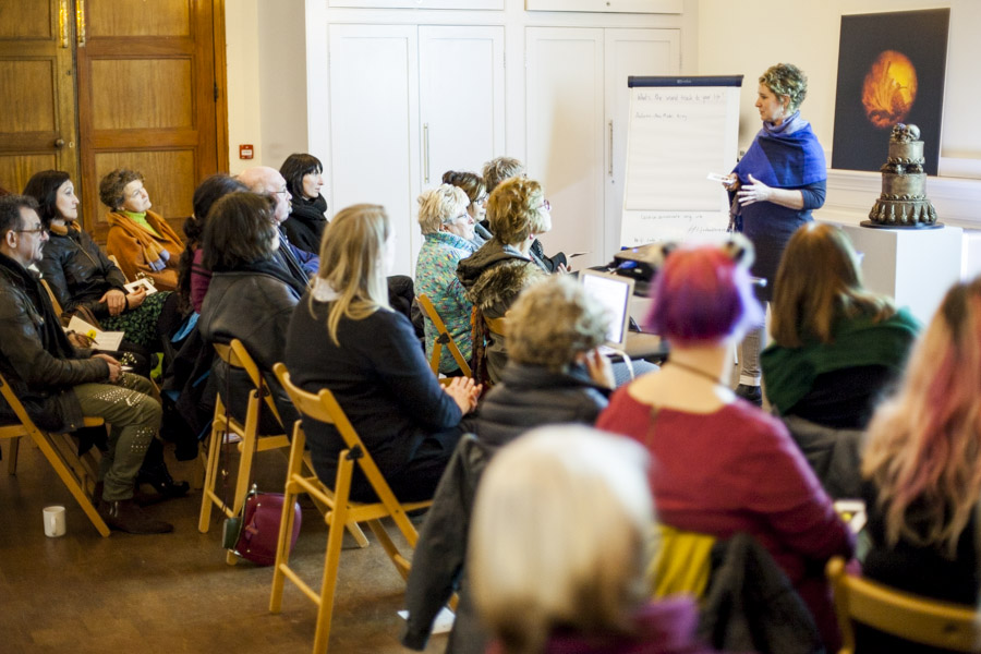 Photo of ruth davey giving a mindfulness photography talk to room of delegates