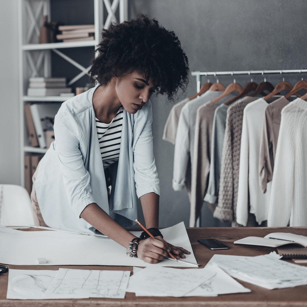 shutterstock_589230362_woman working_cropped.jpg