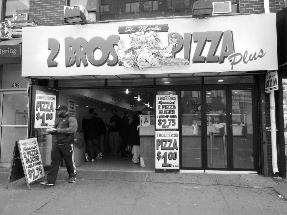 2 BROS. PIZZA:$1 Cheese slice - Most New Yorkers know 2 Bros Pizza for the simple fact that it's everywhere and they have huge signs that proudly share their $1 pizza slice offer.