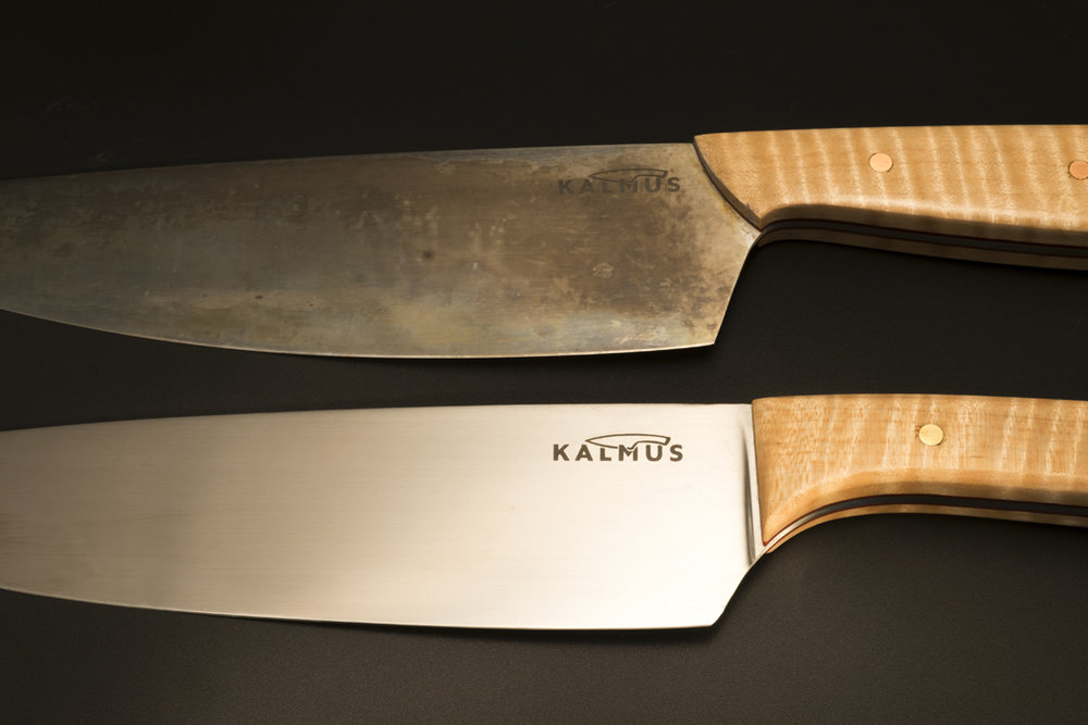 Similar knives, carbon steel and stainless steel.