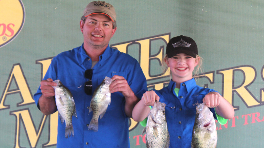 The father/daughter team of Mark and Olivia Arnold, who weighed in 16.95 pounds, were awarded the top Adult/Youth prize of a $100.00 Everhart's Outdoor Store gift card and a Minn Kota Trolling Motor.
