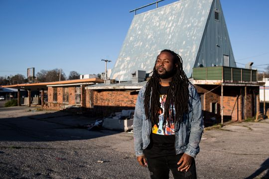 Artist, Jamond Bullock in front of old Whataburger in Frayser