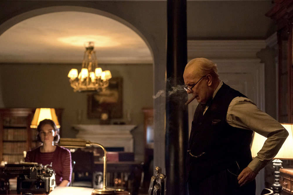 Gary Oldman as Winston Churchill and Lily James as Elizabeth Layton.