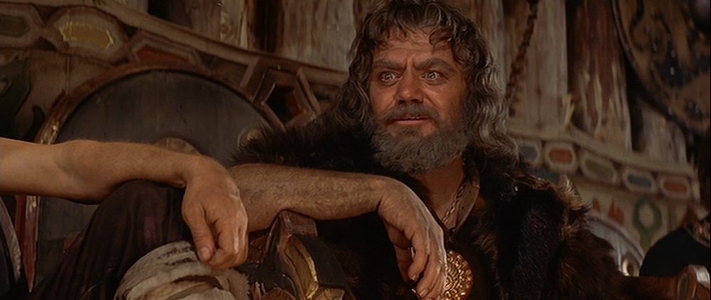 Ernest Borgnine as Ragnar in his hall in  The VIkings