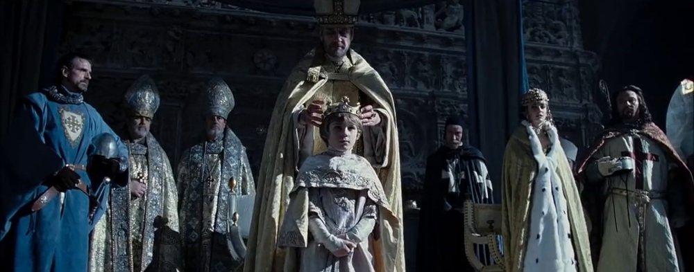 The coronation of King Baldwin V of Jerusalem in  Kingdom of Heaven . Tiberias (Jeremy Irons), Sibylla (Eva Green), and Guy of Lusignan (Marton Csokas) look on.