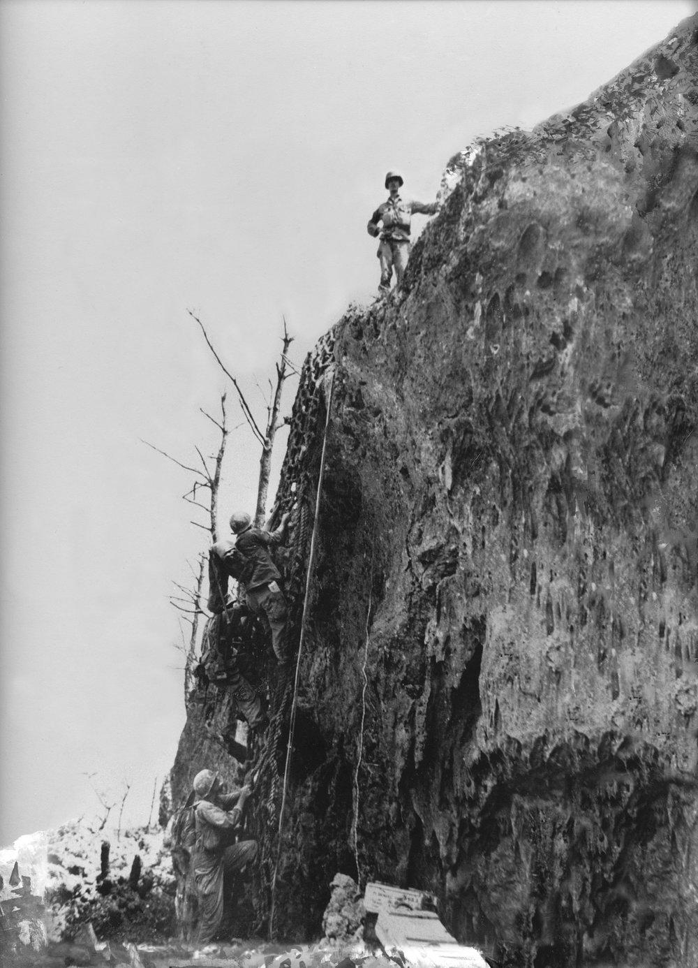 Desmond Doss standing above the cargo nets on the Maeda Escarpment, 1945