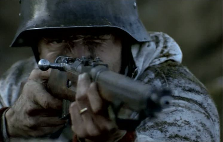 Martti (Taneli Mäkelä) aims his rifle during a Russian assault