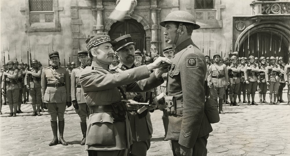 Sgt. Alvin York receives the Croix de Guerre from Marshal Foch in a Warner Brothers publicity still from  Sergeant York .