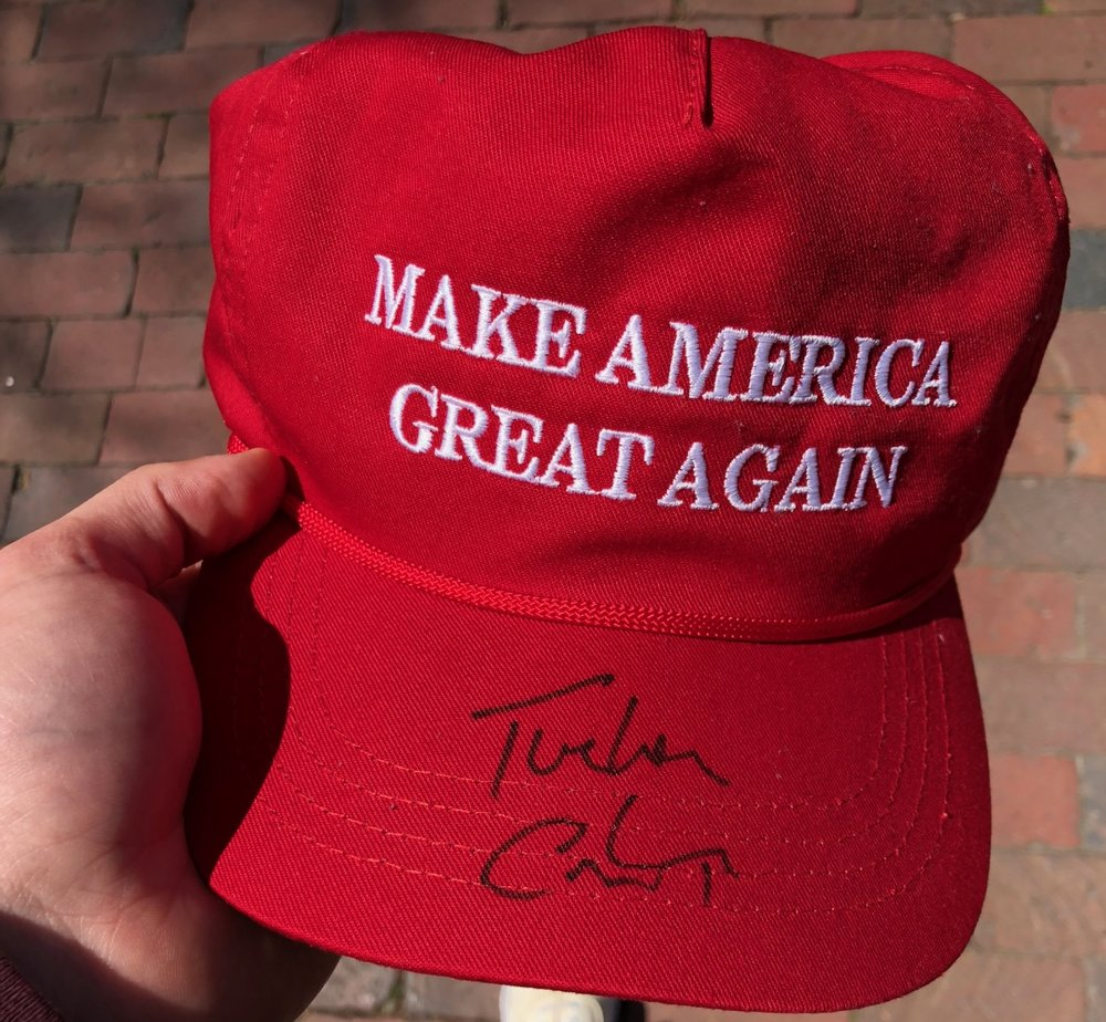 Kosnitzky's MAGA hat, signed by Tucker Carlson.From a recent article on The Carolina Review .