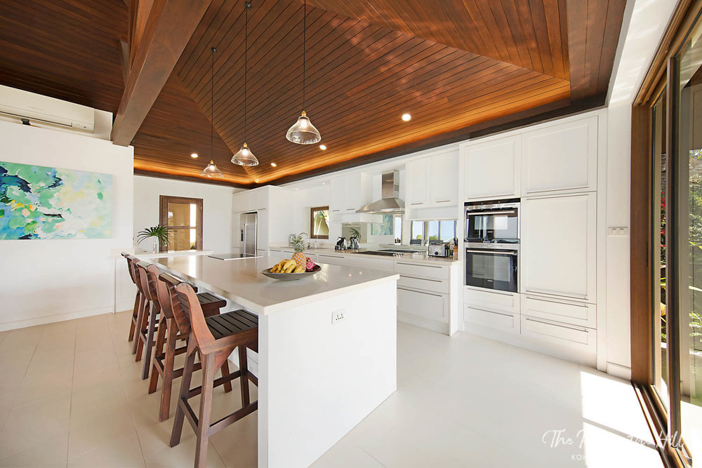 Thai villa: Private chef, catering and grocery pre-stocking options in Koh Samui, Thailand – The large kitchen island seats up to five people and offers ocean views plus floor-to-ceiling windows