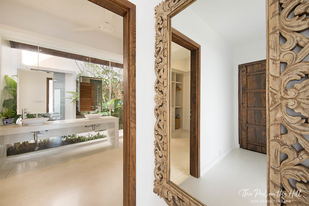 5–Bedroom Villa in Thailand: The entrance to the second master bedroom, and its en suite bathroom with double vanieties and large walk-in closet