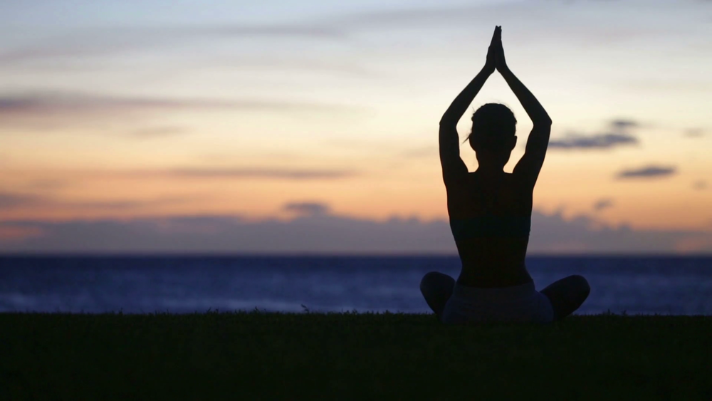 videoblocks-meditation-yoga-woman-meditating-at-beach-sunset-or-sunrise-relaxing-in-yoga-pose-serene-relaxed-female-yoga-instructor-in-calm-nature-sea-scene_rfvirhfj_thumbnail-full01.png
