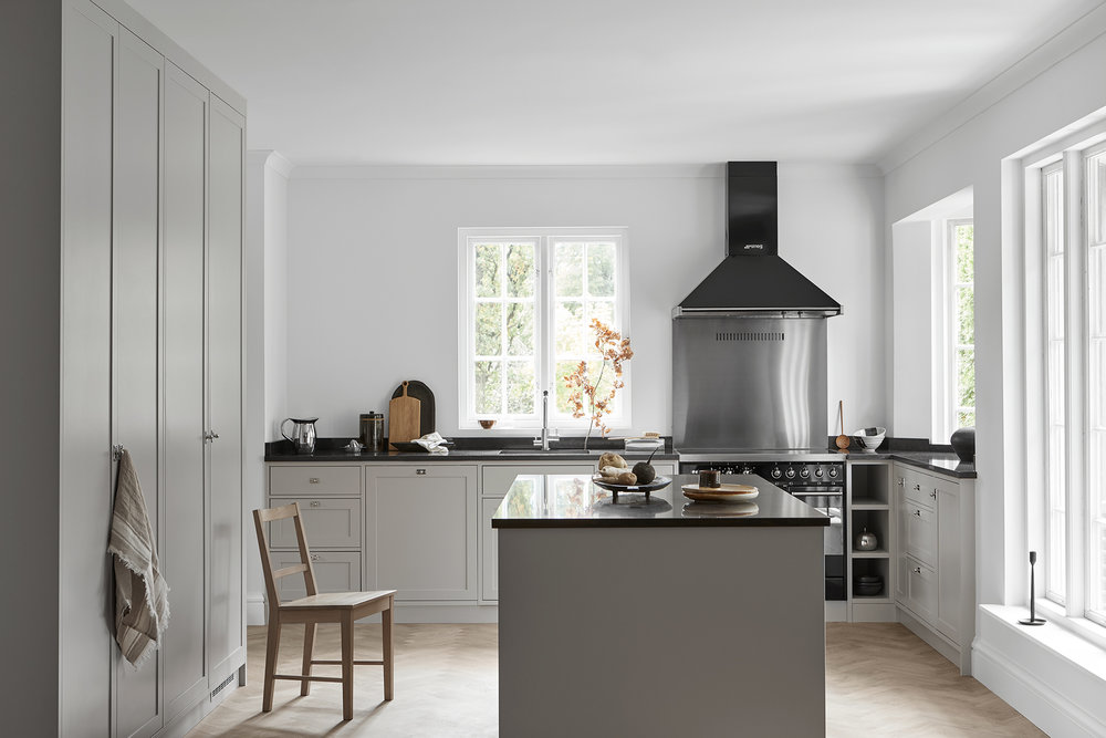 A bespoke Scandinavian shaker kitchen. A soft light grey color with black details as a contrast. Built-in dishwasher and stow from Smeg. Huge kitchen island with built-in cabinets.   Price on request     See more pictures