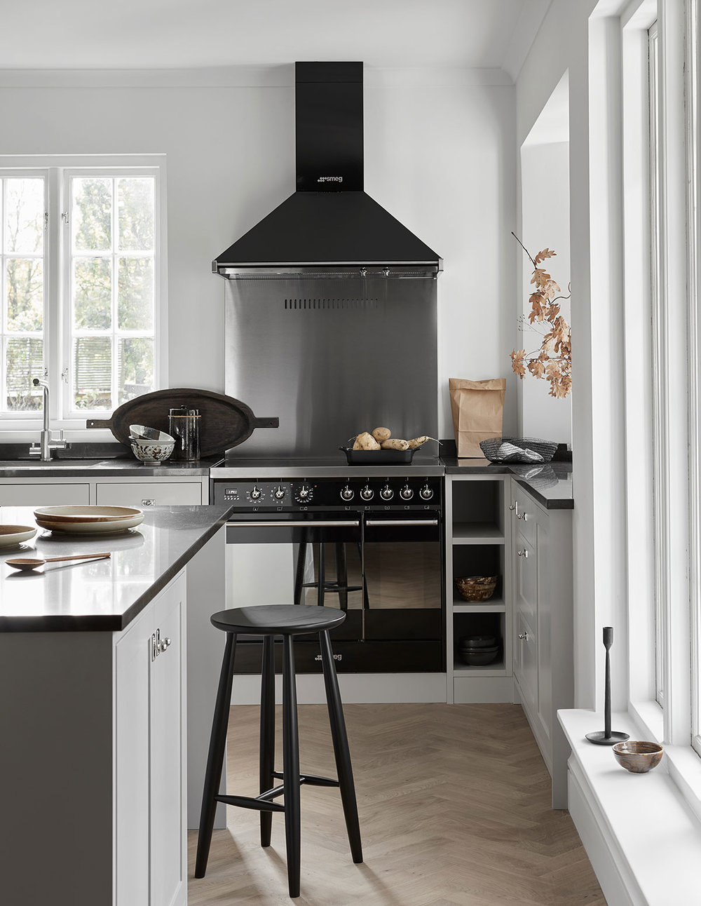 Classic Scandinavian shaker kitchen design in grey black stove and fan