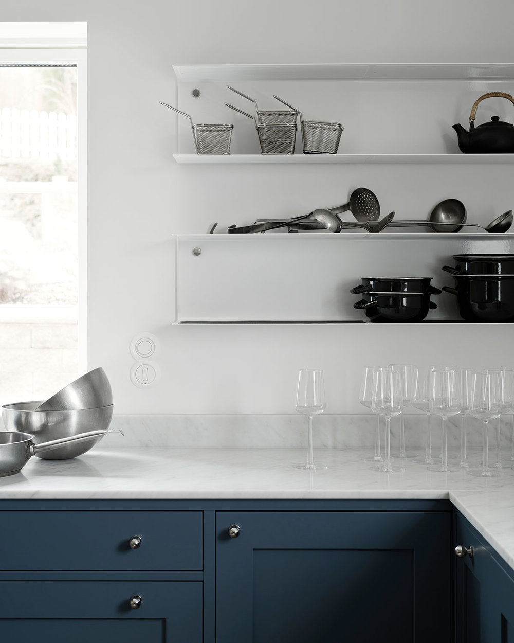 shaker kitchen design in blue, iitalla candle and white Carrara marble and Gubi lamp