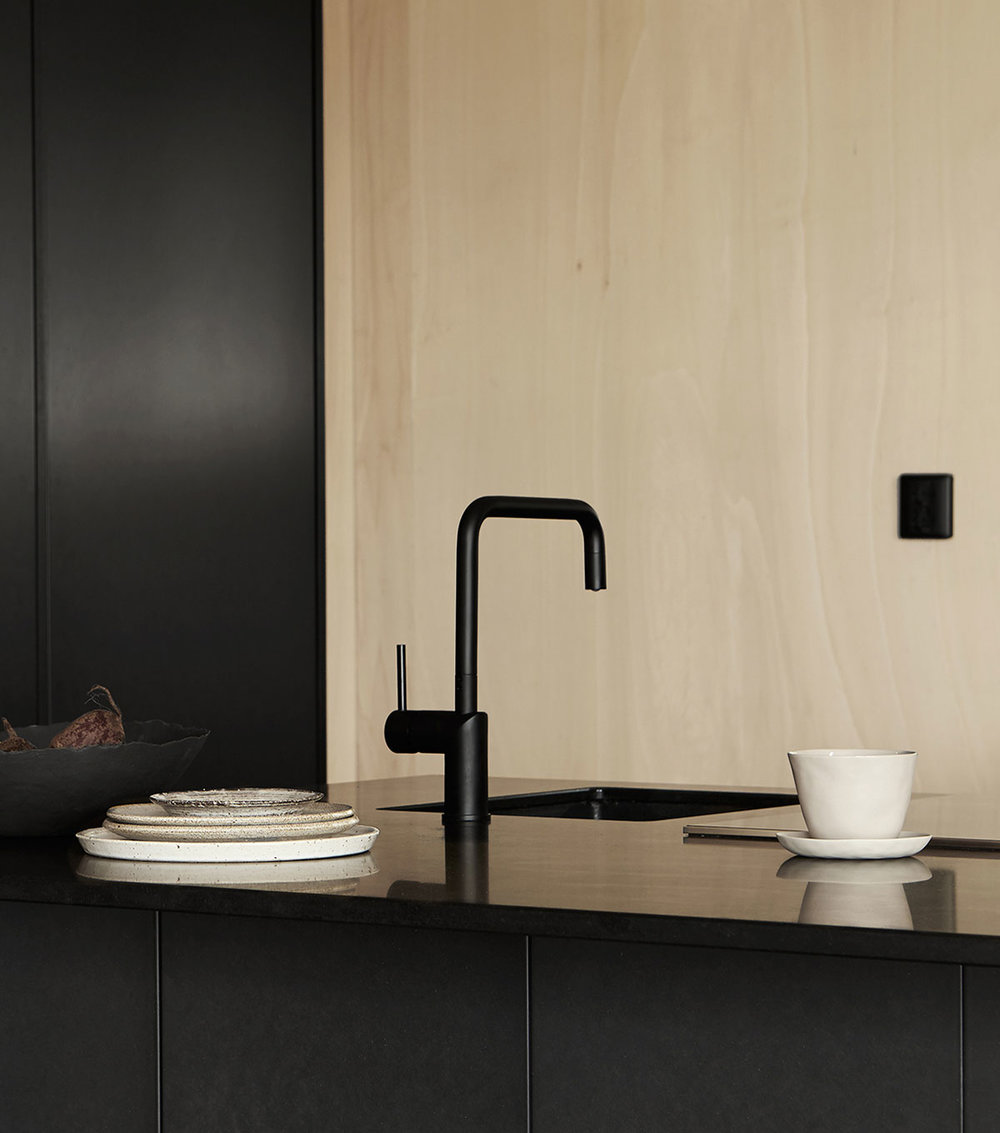Bespoke black architect kitchen design and faucet for Emma Bernhard