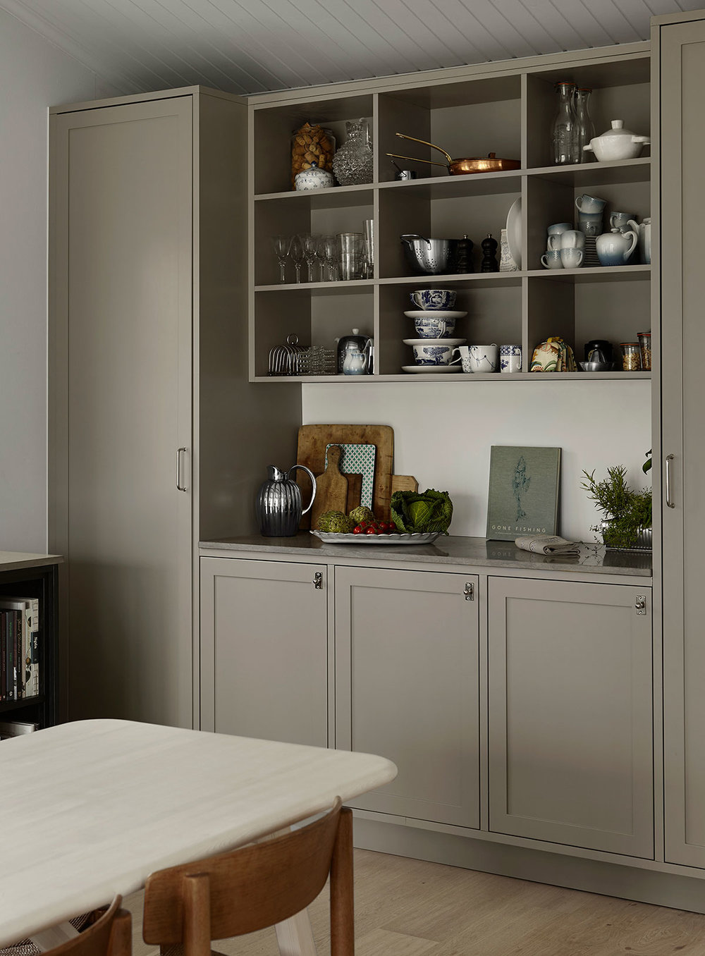 Johanna Bradfords kitchen, grey cabinets and limestone countertop