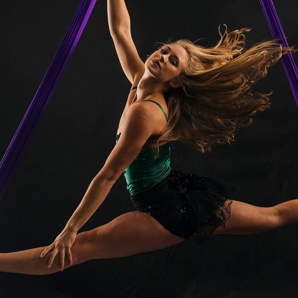 Katie Herndon  - Katie is a professional aerialist and acrobat as well as Rose City Circus's marketing manager and point of contact for clients and talent. She currently performs with AIDA cruise lines as well as several event companies and circus groups. Her specialties include aerial fabric, straps, multicorde, duo acrobatics, tumbling, and flying trapeze.