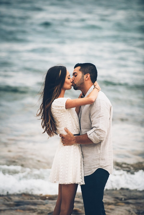 Tahoe beach engagement photos. Captured by Lauren Lindley Photography. Featured on Trendy Groom.